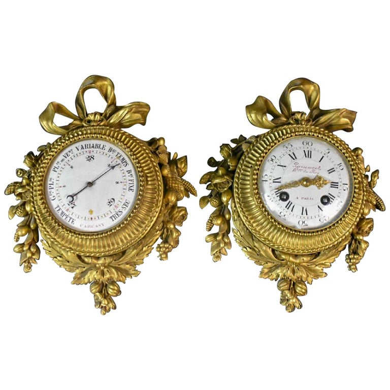 Pair of Louis XVI Style Gilt Bronze Wall Clocks and Barometer For Sale