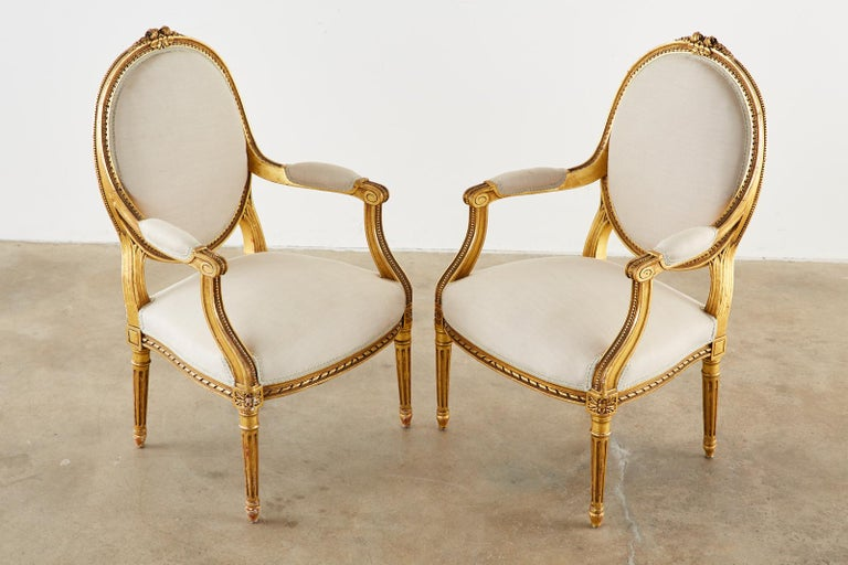 French Pair of Louis XVI Style Giltwood Linen Fauteuil Armchairs
