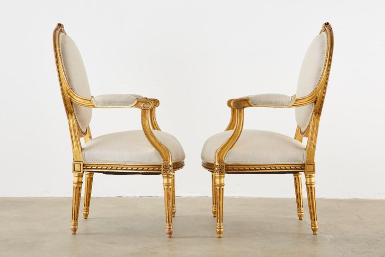 Hand-Crafted Pair of Louis XVI Style Giltwood Linen Fauteuil Armchairs