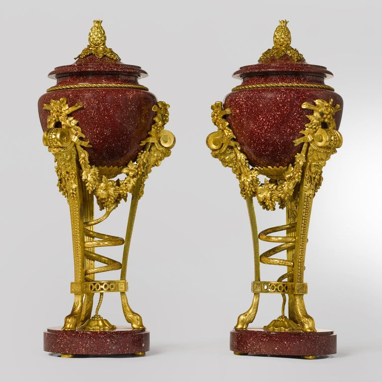 Gilt Pair of Louis XVI Style Porphyry Urns, after Pierre Gouthière For Sale