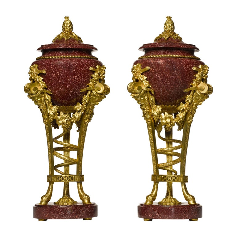 Pair of Louis XVI Style Porphyry Urns, after Pierre Gouthière For Sale