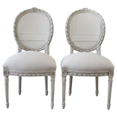 Pair of Louis XVI Style Ribbon Carved Cane Back Side Chairs