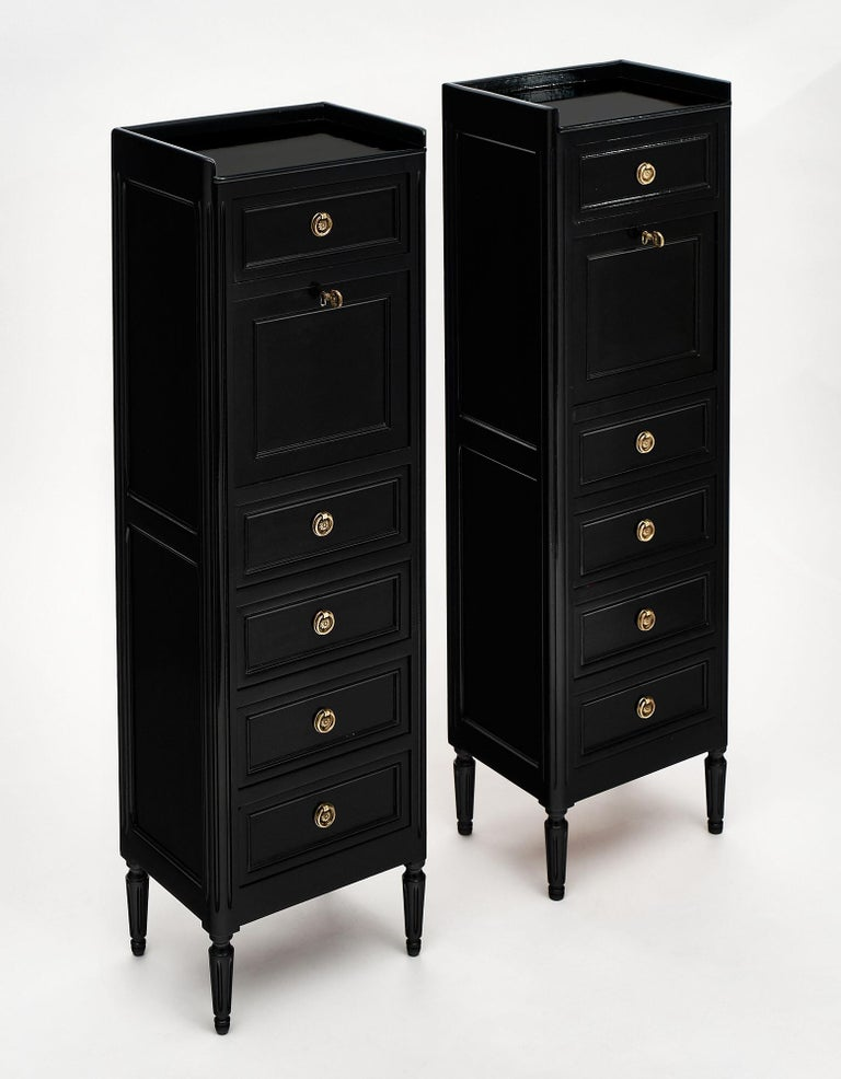 """Pair of """"secretaires"""", French, made of cherry wood in the Louis XVI style. The pair has been ebonized and finished in a lustrous museum quality French polish. We love the drop front opening to an intimate work space with an embossed green leather"""