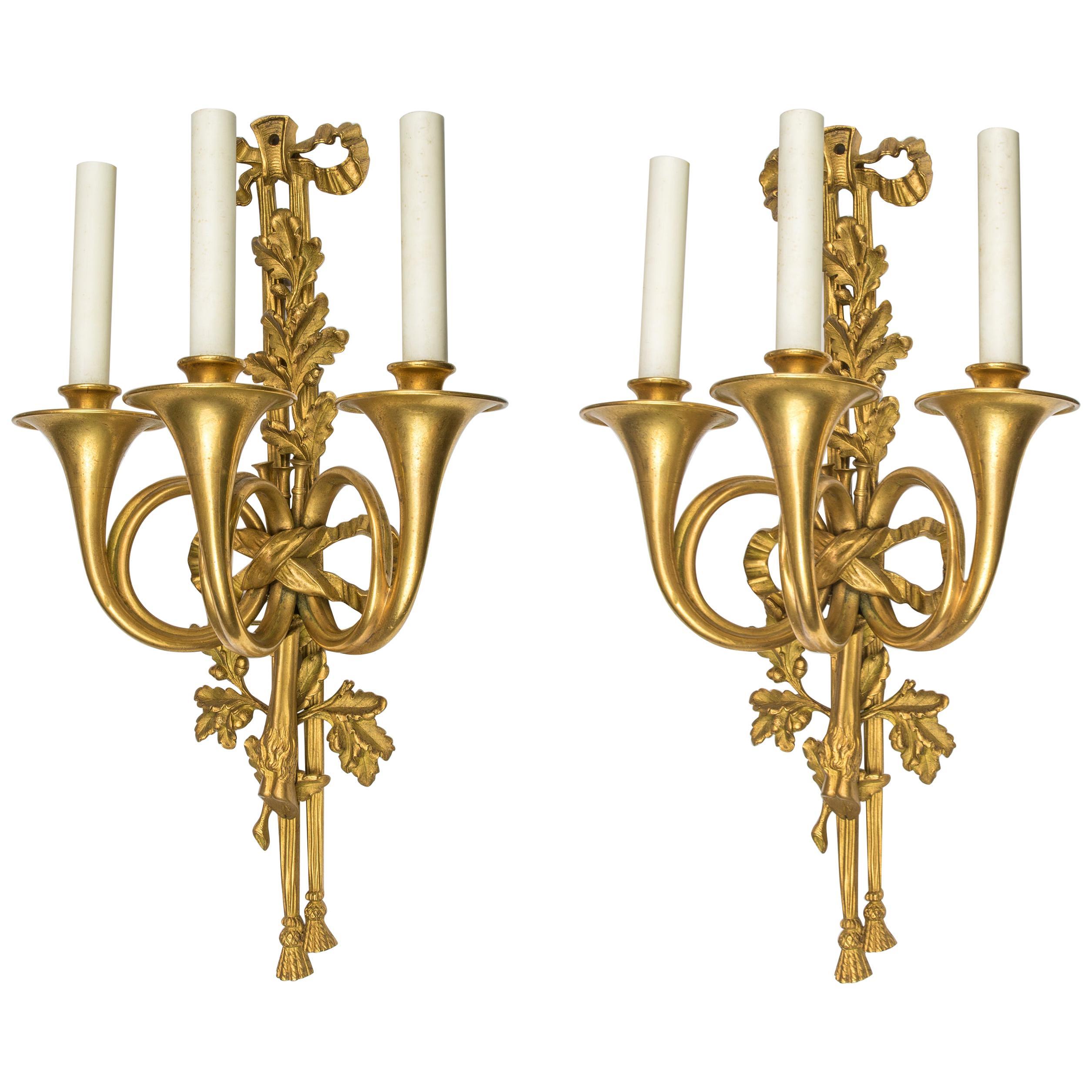 Pair of Louis XVI Style Three-Light Gilt Bronze Wall Sconces