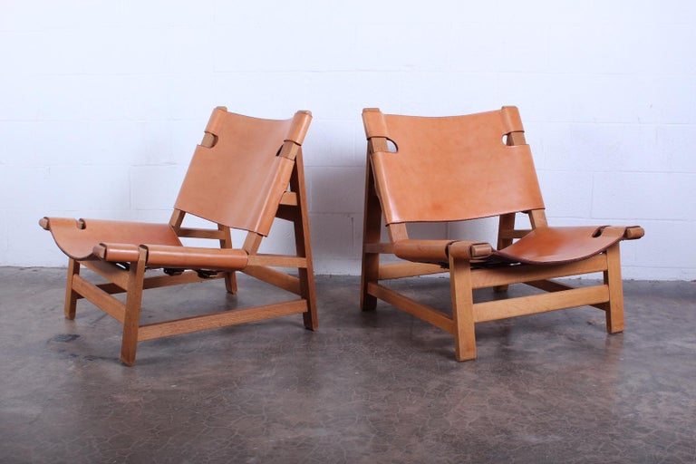 A pair of oak and leather armless lounge chairs by Børge Mogensen for Fredericia, 1967.