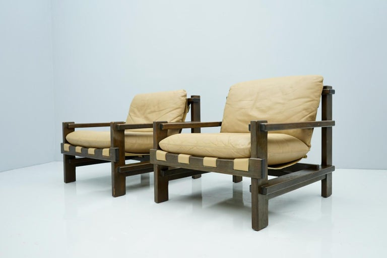 Pair of lounge chairs by Carl Straub, Denmark, 1960s. Stained oak and light brown leather. Beautiful details. Good to very good condition.