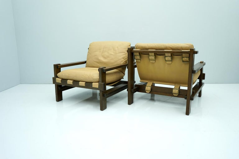 Danish Pair of Lounge Chairs by Carl Straub Denmark 60s in Oak and Light Brown Leather For Sale