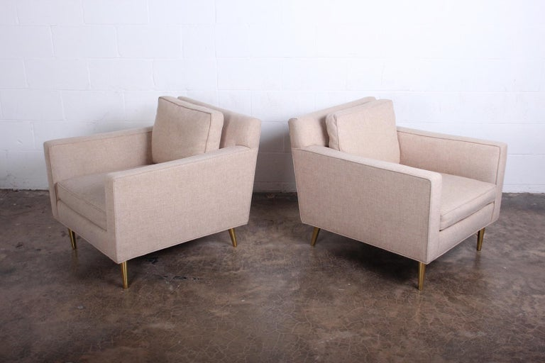 A pair of 4872A lounge chairs with brass legs. Designed in 1948 by Edward Wormley for Dunbar.