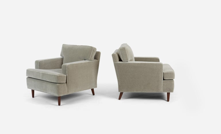 Pair of lounge chairs by Edward Wormley for Dunbar. Fully restored. Legs have been refinished in an espresso tone. New light grey mohair with new feathers and foam cushions. Dunbar model 4872a. Beautiful and Classic Dunbar form.