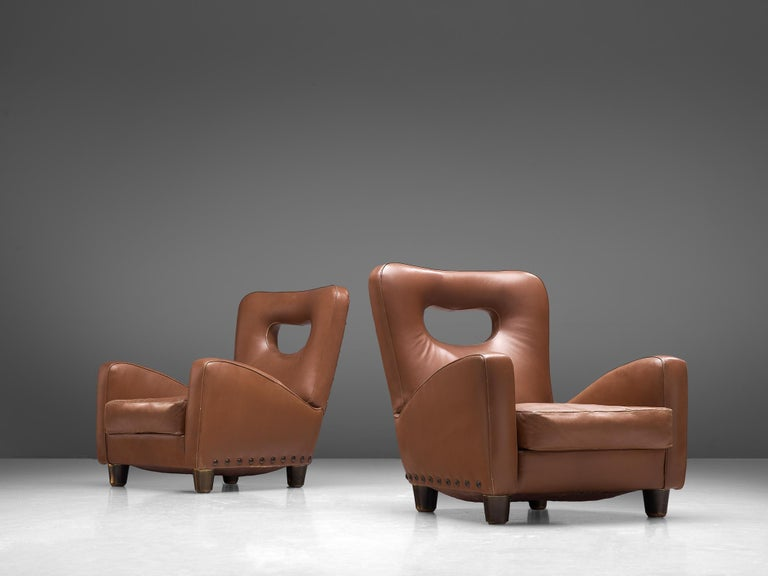 Giovanni Gariboldi for Colli, pair of lounge chairs, leather, wood and bronze nails, Italy, circa 1950.