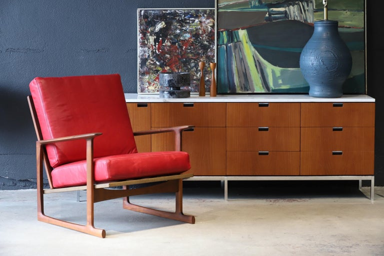Absolutely luscious pair of lounge chairs designed by Ib Kofod-Larsen for Selig in red Italian leather. Both retaining Made in Denmark badge. Pictured with Florence Knoll credenza and Eames LTR for scale.