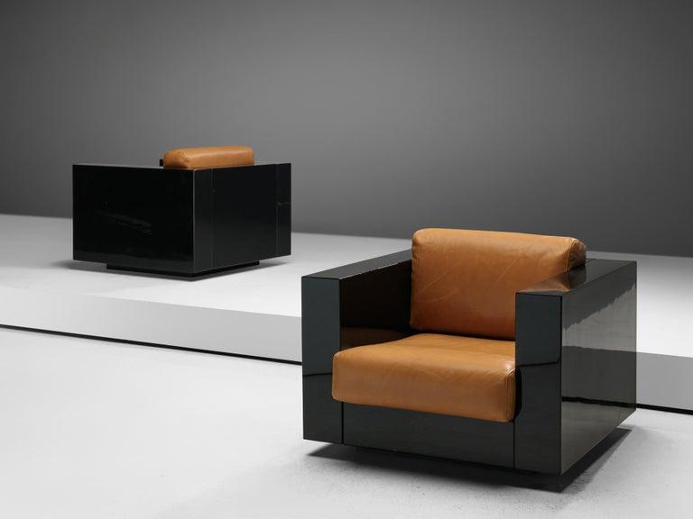 Pair of lounge chairs, Lella & Massimo Vignelli, black lacquered polyester and cognac leather, Italy, 1964.  Massimo and Lella Vignelli for Poltronova designes the Saratoga living room set inblack lacquered polyester and cognac leather in 1964.