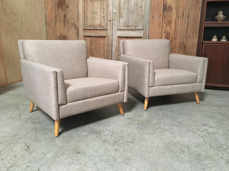 Paul McCobb for Planner Group very angular with sharp edges and sprawled maple legs and new upholstery.