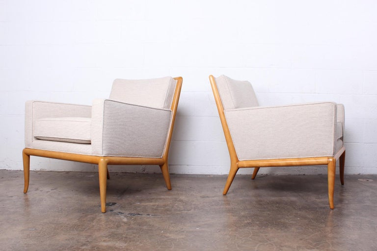 A pair of beautifully restored lounge chairs designed by T.H. Robsjohn-Gibbings for Widdicomb.