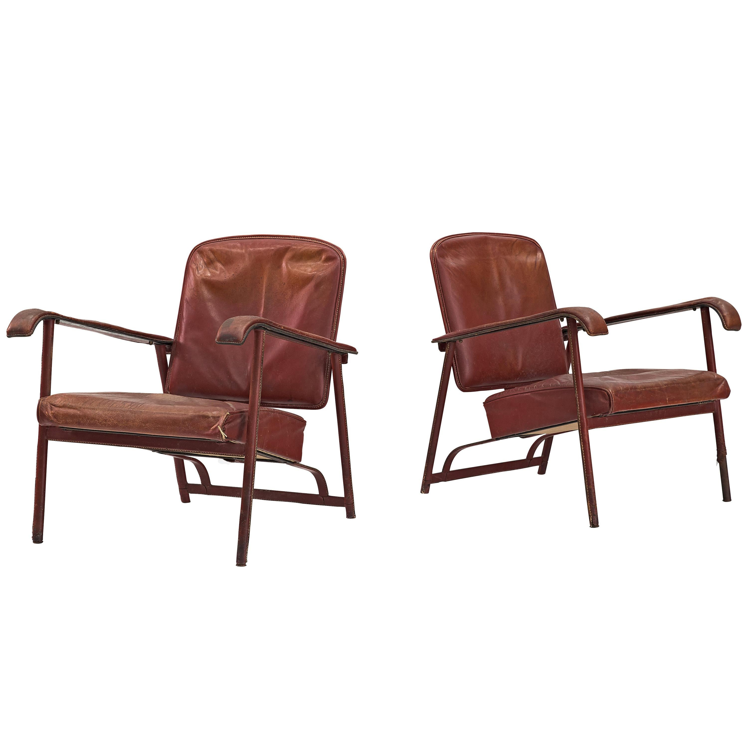 Pair of Lounge Chairs in Patinated Burgundy Leather by Jacques Adnet