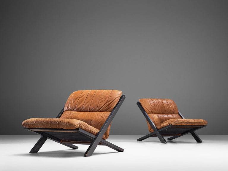 Ueli Berger for De Sede, pair of lounge chairs, wood and leather, Switzerland, 1970s.
