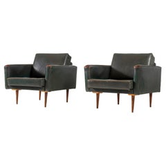 Pair of Lounge Chairs in Patinated Dark Green Leather