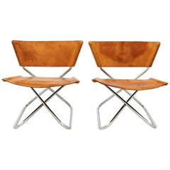 Pair of Lounge Chairs in Saddle Leather and Steel by Erik Magnussen, Denmark