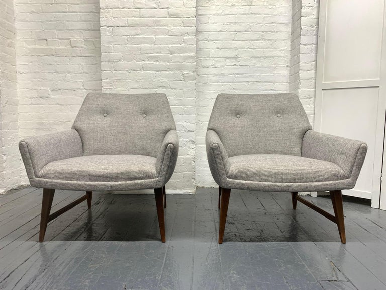Pair of lounge chairs style of Raphael. Has solid walnut legs and newly reupholstered.
