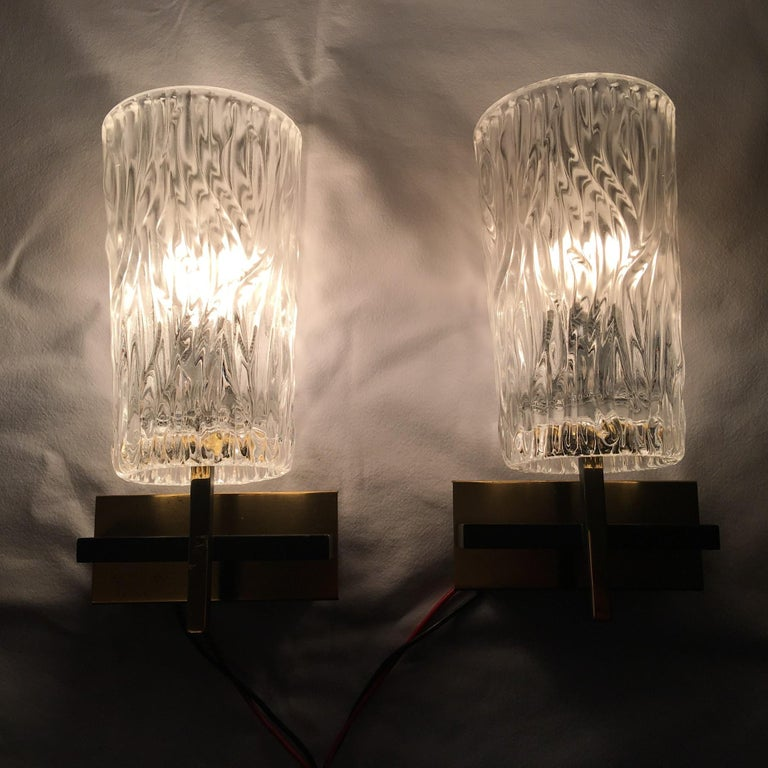A pair of glass covered Kalmar style sconces. Made of glass, iron and tin. Newly wired to conform to US standards. 3.5/8 '' by 1.7/8 inch wall attachment cover. Each one requires a European E 14 Candelabra bulb up to 40 Watts. Very nice set from the