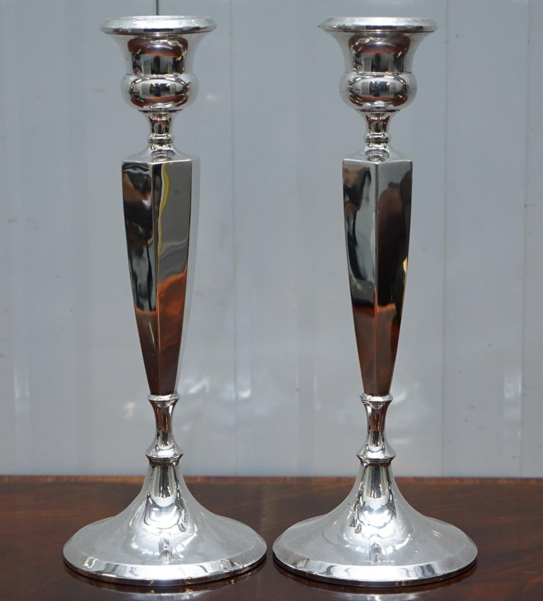 We are delighted to offer for sale this lovely pair of King George V Sterling silver candlesticks, 1920  A nice decorative pair, very tall and elegant Birmingham made and very elegant  Date letter V for 1920  The ships anchor for