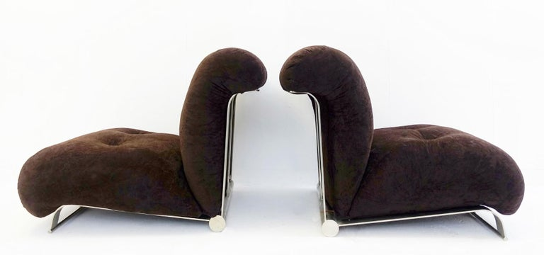Pair of low armchairs brushed chrome with brown velvet cushions, circa 1970s