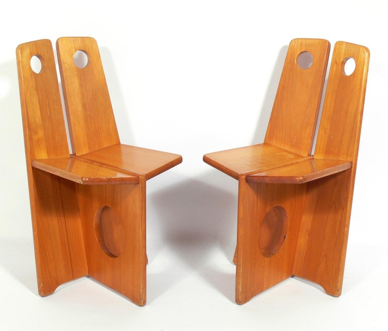 Pair of low slung constructivist chairs, German, circa 1950s. Design clearly influenced by Russian constructivism. Well worn, Industrial vibe with warm original patina. They are a low slung lounge size, and appear to be kid sized, but are actually