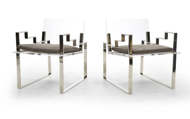 Extremely rare pair of acrylic / Lucite and chromed steel lounge chairs with arms designed by Charles Hollis Jones, 1984. The Lucite is excellent: no chips and very few if any light scratches. One chair arm has a few light scratches. The leather