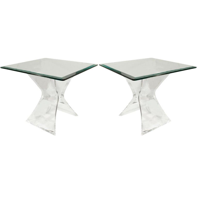 Pair of sculptural end tables with bases in Lucite with glass top, American, 1970s.