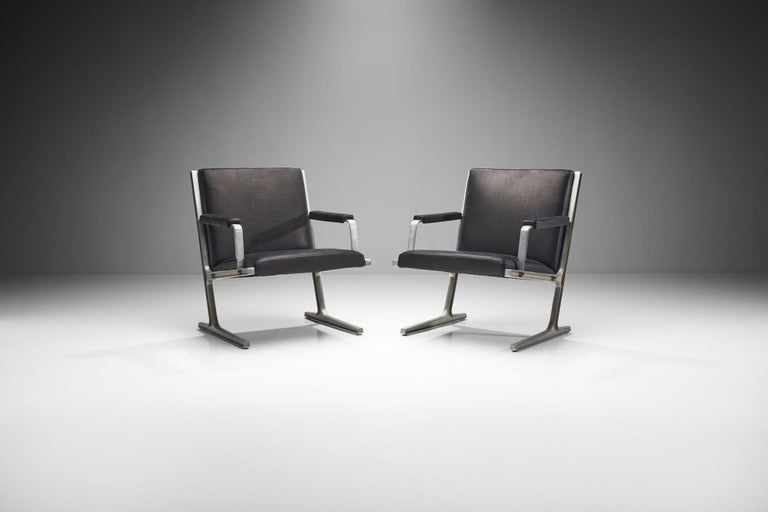 """This pair of armchairs from the """"Series 186"""" is also known as the """"Lufthavns-stole"""" (Airport chairs). The model was designed in 1969 for Cado collection.  The aluminum frame is without a doubt the most dominant feature of these chairs. The sturdy"""