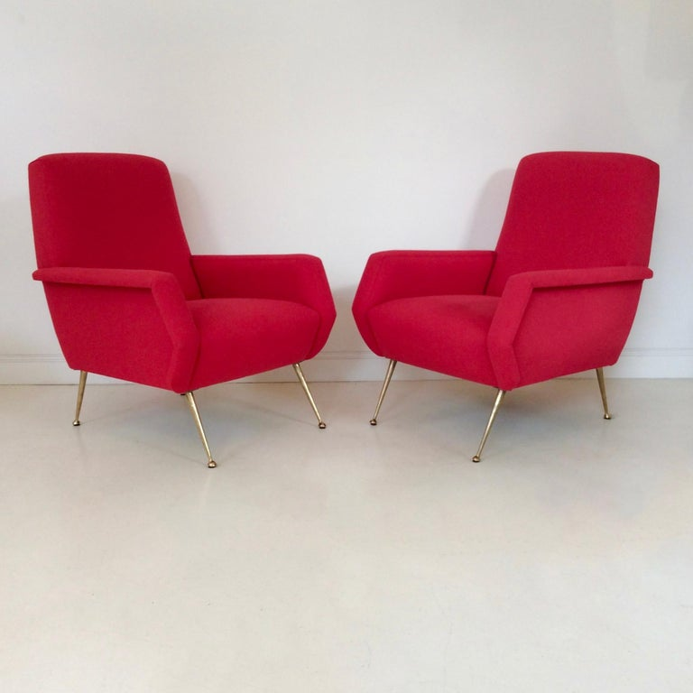 Nice pair of armchairs by Gidi Radice, circa 1950, Italy. Brass and light red fabric. New upholstery. Dimensions: 92 cm H, 69 cm W, 89 cm D, seat height: 45 cm. Very good condition. We ship worldwide.