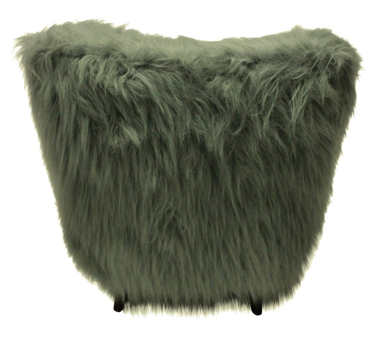 A pair of Italian midcentury extremely comfortable armchairs in faux fur.