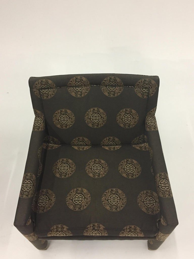 Sophisticated pair of upholstered club chairs attributed to Milo Baughman having an Asian circular geometric pattern. The arms and legs are also seamlessly upholstered to give a sleek contemporary look. Chairs are circa 1970, upholstery is much