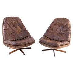 Pair of Madsen and Schubell Leather Upholstered Danish Swivel Chairs
