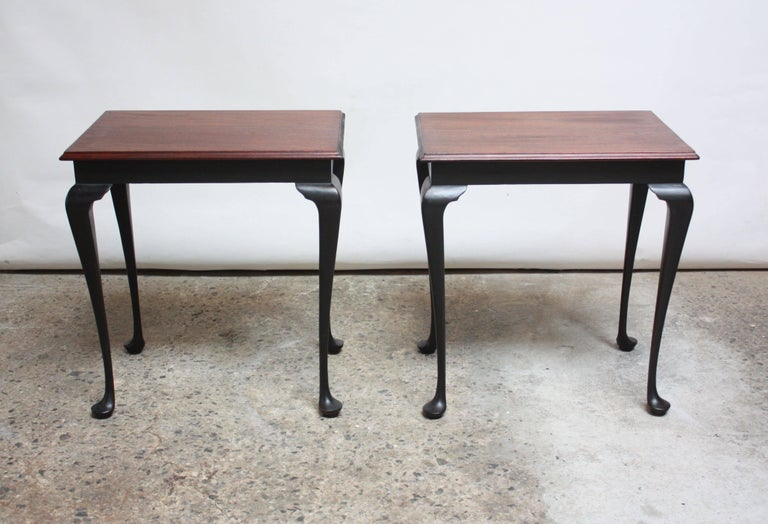 Pair of Chippendale style side tables (circa 1950s, USA) composed of ebonized walnut cabriole legs / knees with stained mahogany tops.  Retain original, black paint, which is in very good condition for its age. Scuff to one of the tops and general,
