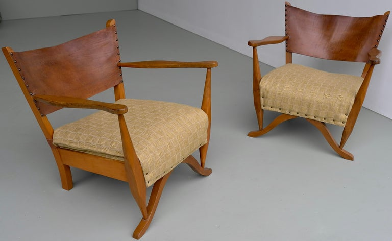 Pair of mahogany armchairs with natural sling leather back, Denmark 1960s.