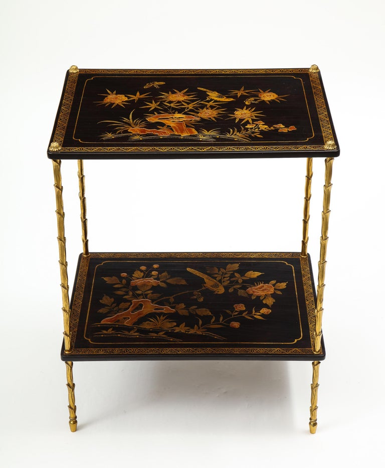 Mid-20th Century Pair of Maison Baguès Black Lacquer and Gilt Two-Tier Tables For Sale