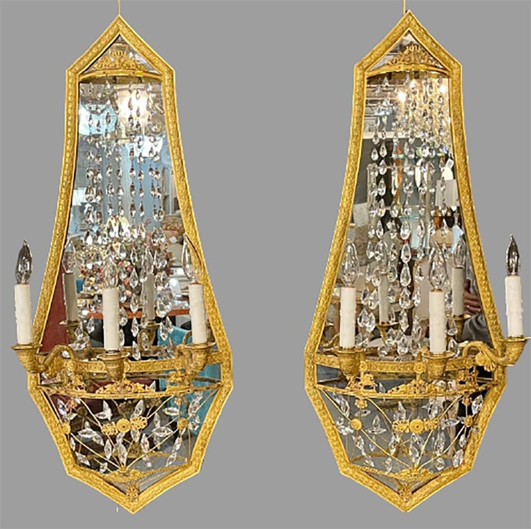 Pair ofMaison Baguès mirrored wall lights, sconces. This stunning pair of large and very impressive wall sconces in a dore bronze finish having a Russian neoclassical flair are certain to make a statement in any area of the home. These rare and