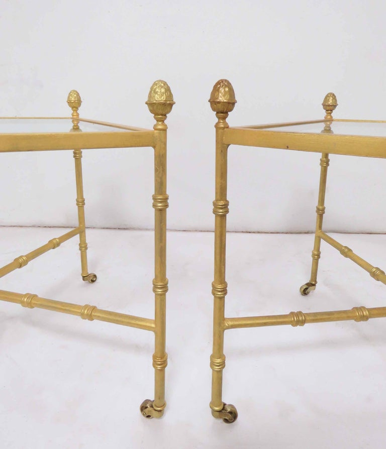 Hollywood Regency Pair of Maison Baguès Style Gilt End Tables with X-Stretchers and Acorn Finials For Sale
