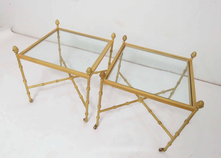 Mid-20th Century Pair of Maison Baguès Style Gilt End Tables with X-Stretchers and Acorn Finials For Sale
