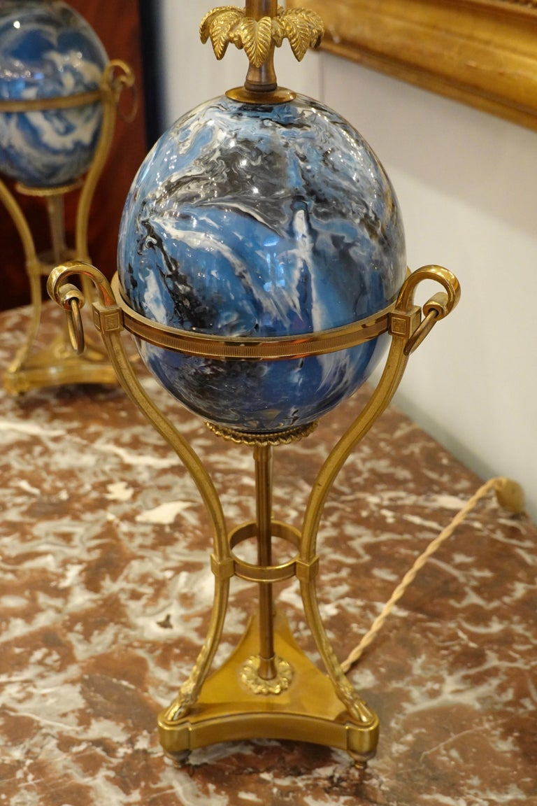 Brass Pair of Maison Charles Neoclassical Tripod Form Lamps with Blue Ostrich Egg For Sale