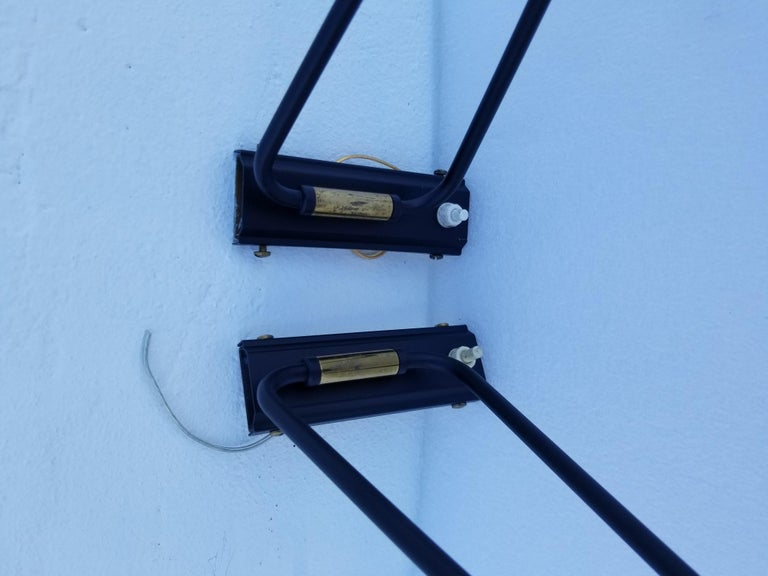 Pair of Maison Lunel Retractable Sconces In Good Condition For Sale In Miami, FL