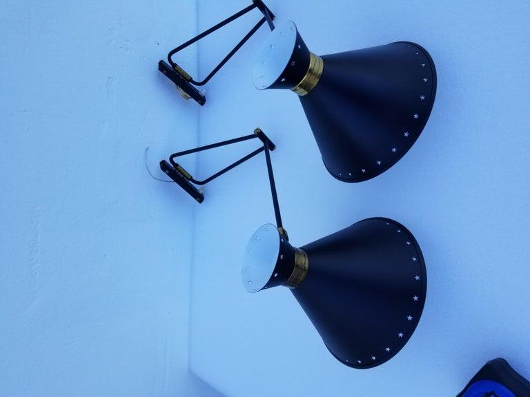 Brass Pair of Maison Lunel Retractable Sconces For Sale