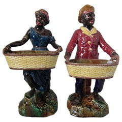 Pair of Majolica Blackamoor Figures Holding Baskets