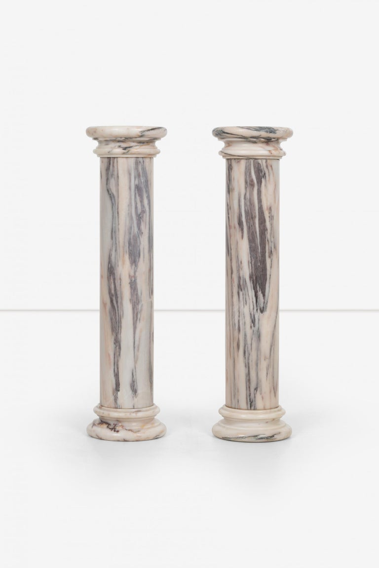 Pair of marble architectural display columns in Calacatta pink quarried in Italy.  Measures: Height: 31.5