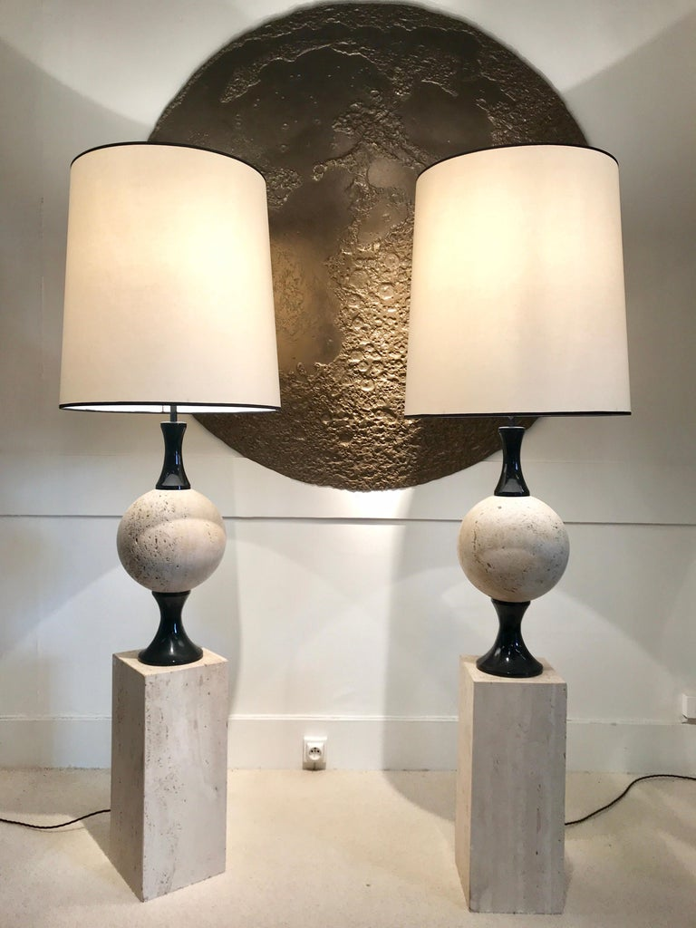 Pair of marble floor lamps on travertin marble by Philippe Barbier Black lacquered metal details Great vintage condition Rewired.