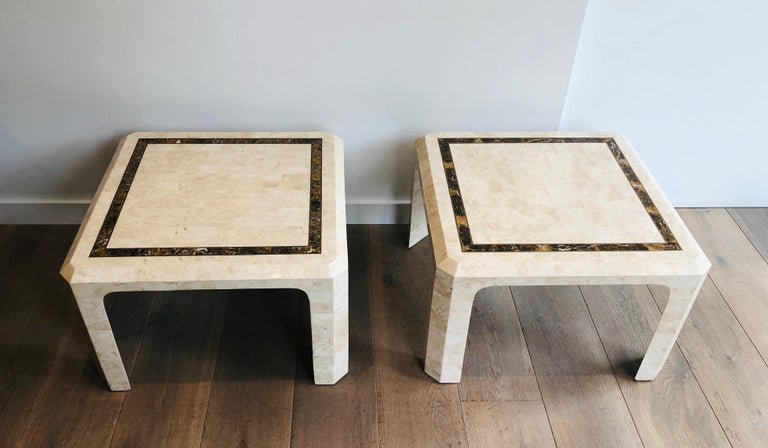 This very nice and elegant pair of side tables is made of marble plates with a brass line. This is a French work, circa 1970.