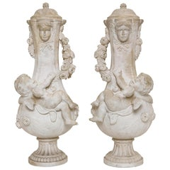 Pair of Marble Urns with Cherubs, Signed A. Moreau