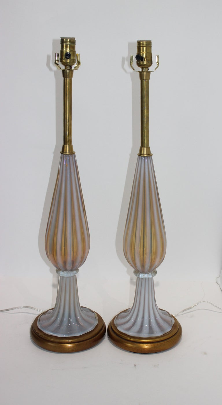 This stylish pair Marbro table lamps were created by Seguso (Murano Glass) for the Marbro Lamp Company and they date to the 1960s.  The pair has been rewired and new sockets.    Note:  Height to top of socket is 27.75