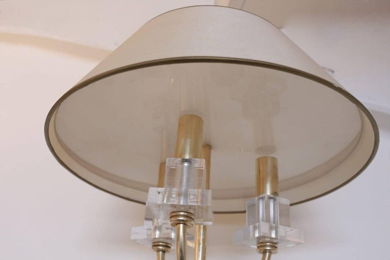 Elegant pair of Marcel Asselbur sconces, 1950s  Round back plate with